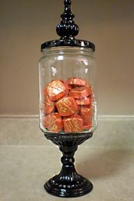 I LOVE this idea!! These are made from pickle jars!! Glued onto a spray painted dollar store candle holder, decorative finneal added on top. Can fill with candy prior to giving as gift! Can be used in kitchen as candy, tea, or anything storage, or in the bathroom as Q-tip  cotton ball storage. Awesome!