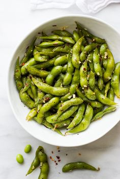 Garlicky edamame with a spicy kick. Rich in flavor and extremely addicting. Only four ingredients and about 10 minutes from start to finish!