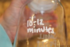 Oil based marker to label glass jars and use lemon essential oil to remove it.