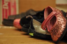 Pile of shoes from whole family or put in pattern design on floor