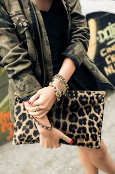 leopard print clutch and camo parka