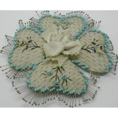 A silk and bead work pin cushion. c 1830