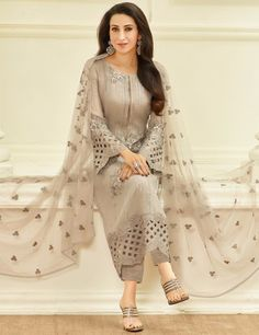 You beauty P be the center of attention like Karisma Kapoor in this beige color embroidered georgette pant style suit. The ethnic lace, sequins and resham work in the attire adds a sign of elegance statement to your look. Pakistani Dress Design, Pakistani Outfits, Indian Outfits, Kurti Designs Party Wear, Kurta Designs, Blouse Designs, Trajes Pakistani, Chifon Dress, Fashion Pants
