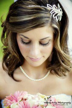 Bride looking at flowers - cute