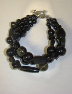 "7 3/4"" black triple strand glass bead bracelet on a silver toggle clasp.  Free shipping!"
