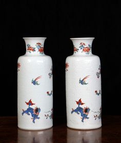 A pair of Chinese Dutch-decorated rouleau vases (c.1710 - 1720) The porcelain Kangxi c. 1710, the decoration Holland c. 1720