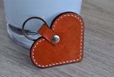 Check out this item in my Etsy shop https://www.etsy.com/nl/listing/231833548/sale-leather-heart-keychain-keyfob