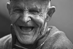 #adult #black and white #close up #elder #elderly #eye #face #facial expression #happy #laughing #man #portrait #sepia #smile