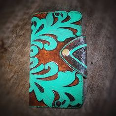 Hand Tooled and Handmade leather phone case turquoise and brown.