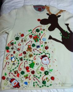 this would be SO easy to make, all you have to do is but a white sweatshirt, paint on the reindeer and a couple of little presents, then hot glue old heels, brooches, omg.