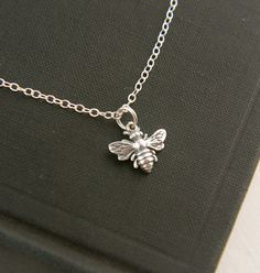Tiny bee necklace in sterling silver, bee necklace, bee hive, bee jewelry, honey bee, bee charm, silver honey bee, sterling silver bee on Etsy, $25.00