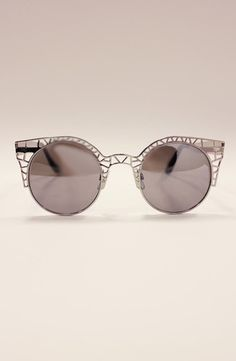 Quay Fleur Silver Sunnies.   http://www.shopcloakroom.com/collections/hats/products/free-people-striped-beanie