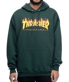 Get a sick skate style with the Flame Logo forest green hoodie from Thrasher. The dark green pullover sweatshirt features a screen printed Trasher Skateboard Magazine text logo on the front with flames and is finished with a fleece lining for comfort.
