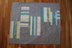Signature quilting on modern strip quilt