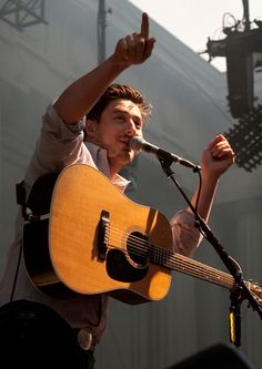 Lead vocalist Marcus Mumford of the English folk rock band Mumford & Sons acknowledges the crowd during a show at the Greek Theatre in Berkeley, Calif., Wednesday, May 29, 2013