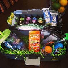 Easter basket I made from a fishing tackle box :)) with fishing lures/ candy in it....