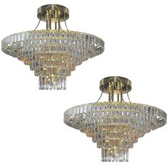 Pair of Impressive Gilt Brass and Crystal Chandeliers