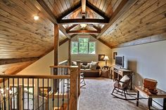 Attic Truss for a Traditional Family Room with a Wood Rocking Chair and Lake Chatuge Safe Harbor by Timberlake Custom Homes, LLC Loft Interior Design, Attic Design, Loft Design, House Design, Interior Paint, Interior Stairs, Interior Ideas, Tan Walls, Small Loft