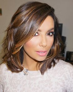 Who made Eva Longoria's tan long sleeve dress?