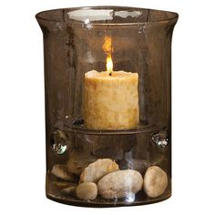 For master bath. Highlighting your favorite pillar candle with a warm brown finish, this textured glass hurricane creates a cozy glow in your living room or bedroom.