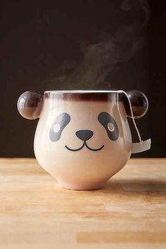 Color-Changing Panda Mug Heat sensitive mug shaped like a panda. Changes color when you pour hot liquid in, so your sleeping panda suddenly wakes up! Just hold onto his ears and enjoy. Great gift idea, too! Sleeping Panda, Panda Love, Panda Panda, Cute Cups, My Cup Of Tea, Mug Shots, Mug Cup, Tea Mugs, Bunt