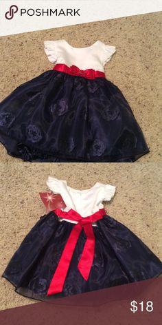 Baby girl dress Princess Faith baby dress in size 12 months.white bodice with navy bottom. It also has matching panties. Very cute. Dresses