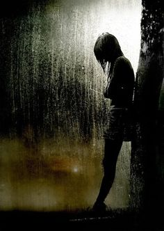 Then the rain came. There she stood alone. Again. But so no one could see her tears.