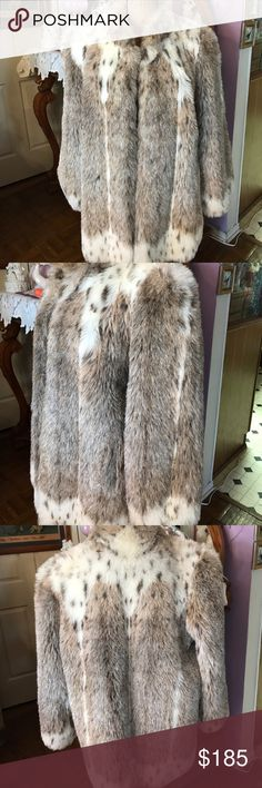 Faux fur lynx coat This faux fur lynx coat is just as beautiful as the real thing. Very warm, and in like new condition, which is unusual since its vintage. Beautiful lining and two nice size pockets. Looks very authentic. Great for evening or with jeans to get groceries on a cold day. No size tag, but I wear a large and fits perfectly over a sweater. Possibly an XL could wear as well. Jackets & Coats