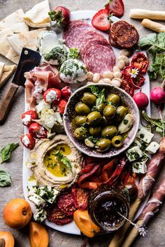 This Greek inspired antipasto platter is so easy to prepare and is perfect for all your summer hosting needs! | Half Baked Harvest