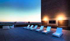 Sunset over the River Tower Condos rooftop - Loll Designs Chaise 405 and Go Collection