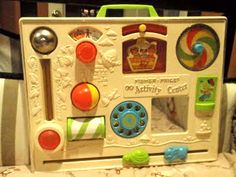 Retro FISHER PRICE. I had one of these as a baby and taught my Jack Russell Terrier how to do every single activity on it!