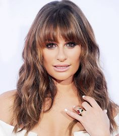 Lea Michele's gorgeous, bronzed skin, smoky eye and bangs are so perfect