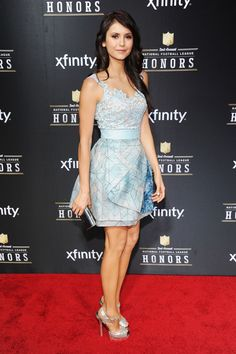 Nina Dobrev at the 2nd Annual NFL Honors in New Orleans in a Zuhair Murad dress paired with Jimmy Choo shoes and clutch.