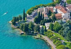 Sail, swim and unwind at a peaceful resort on the shores of Lake Garda - includes breakfast, welcome cocktail, spa access and a spa treatment voucher