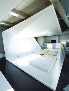 Folded minimalist sleeping area within standard concrete small apartment