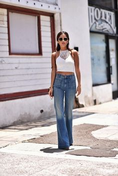 Paola Alberdi from Blankitinerary.com wearing 70s inspired flare jeans with white crochet top.