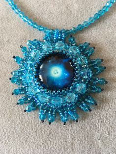 A personal favorite from my Etsy shop https://www.etsy.com/listing/543829656/turquoise-bead-embroidery-necklace