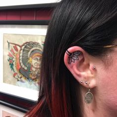 WEBSTA @ trailertrashtattoo - Inner ear flower for Caitlin! Thanks for the trust! Tattooed by @clayton_tattoo Tattoosbyclayton@outlook.com