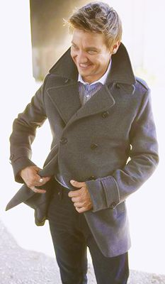 Jeremy Renner ... Smiles and that trench coat!