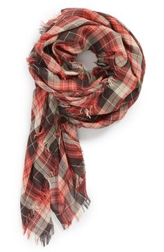 A plaid scarf decked with fringed edges = perfect for fall layering.