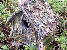 Twiggy birdhouse with mossy bark shingles roof