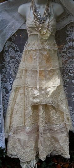 Cream wedding dress handmade by vintage opulence on Etsy  The top is a soft cream/beige stretch lace in tiers with a cotton crochet bust and a