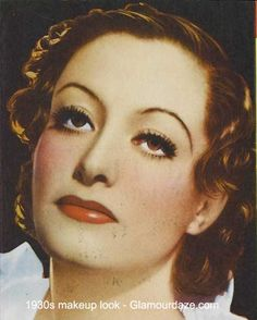 1930s red lips drawn naturally, heavy powder, lower blush, eyshadow blended up to brows