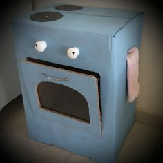 DIY kitchen stove and oven made from cardboard box. Kids playroom.