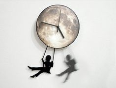 Boy Swinging on the Moon  - Pendulum Wall Clock