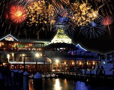 Fireworks light up the sky behind AJ's Seafood and Oyster Bar on Destin Harbor.
