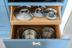Such a great idea to keep pans and lids organised. Oak interiors with Little Greene Bone China Blue paint. Lid Organizer, Little Greene, Handmade Kitchens, Bespoke Kitchens, Blue China, Cabinet Makers, New Builds, Beautiful Kitchens, Surrey