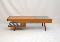 Mid-Century Coffee Table, John Keal for Brown Saltman | From a unique collection of antique and modern coffee and cocktail tables at https://www.1stdibs.com/furniture/tables/coffee-tables-cocktail-tables/