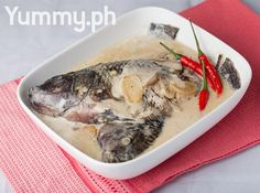 *** Ginataang Tilapia Recipe (Fish Cooked in Coconut Milk):  Serves 4 Preparation Time 10 minutes Cooking Time 20 minutes  2 tablespoons oil 2 cloves garlic, minced 1 medium onion, sliced 1 1-inch sized ginger, sliced 3 to 4 pieces tilapia 1 can (400ml) coconut milk 1 teaspoon fish sauce 2 to 3 pieces finger chillies (optional) 2 to 3 pieces red chillies salt and pepper to taste
