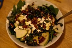 Pear and crispy kale salad with goat cheese, pecans, pears, spinach and a honey mustard vinaigrette.